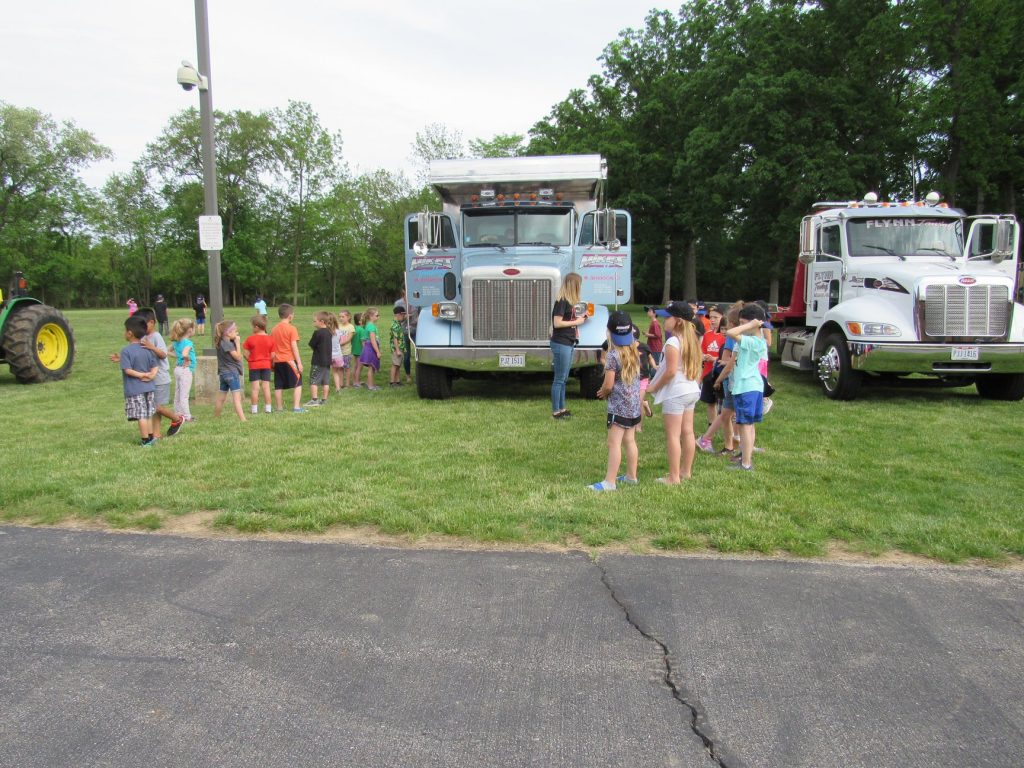 Standing in line at the Touch a Truck event in London, Ohio.